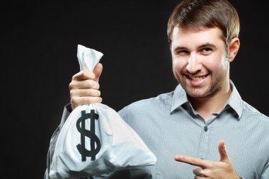 Man holding money bag and winking