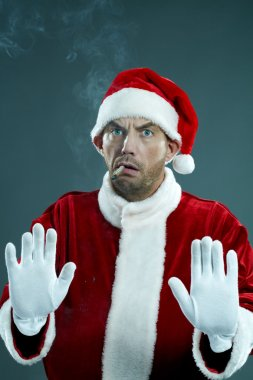 Displeased man in Santa's clothing