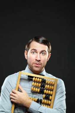 Accountant holding an abacus