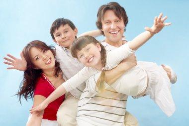 Happy family posing at camera