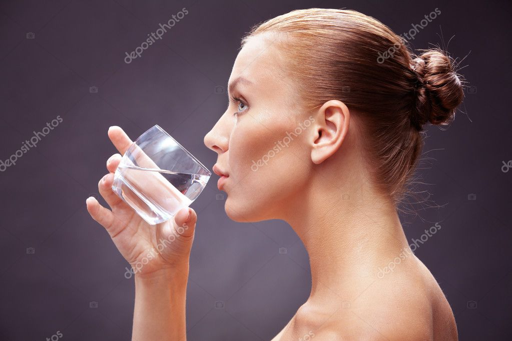 woman with glass of pure water