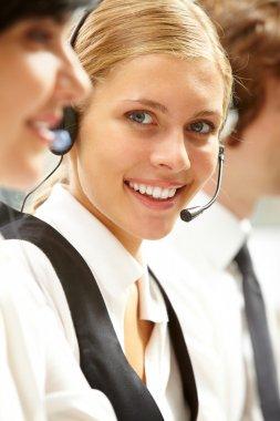 businesswoman in headphones looking at camera