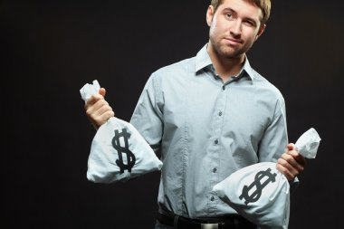 Man standing with two money bags