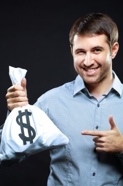 man pointing at money bag and winking