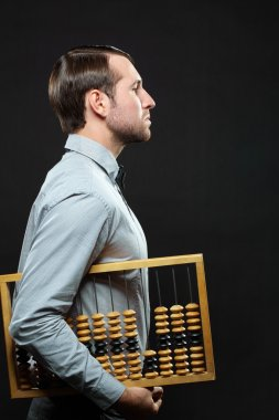 Businessman holding abacus