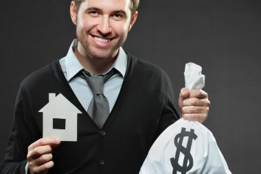 Businessman saving for house