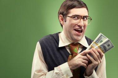Happy nerd counting his money