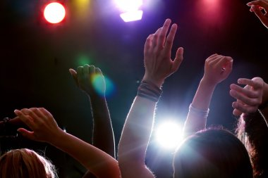 Raised hands of people dancing disco