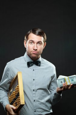 Surprised businessman with money and abacus