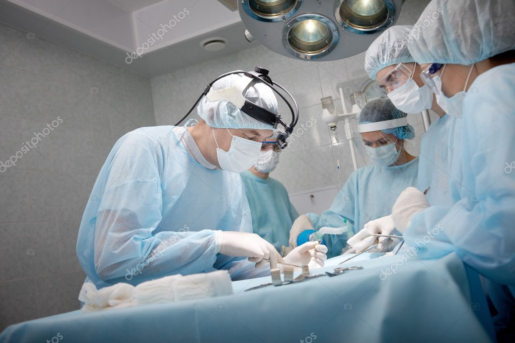 Surgeons saving a patient in operating room