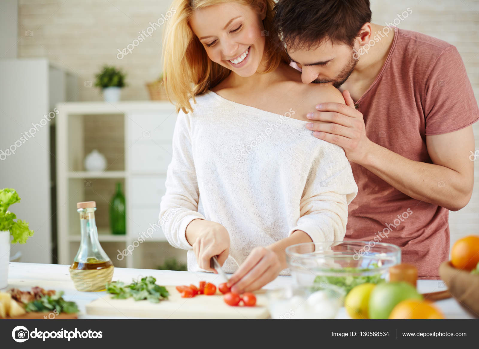 couple cooking salad in the kitchen — Stock Photo © pressmaster ...