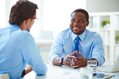 Young businessman sitting at job interview