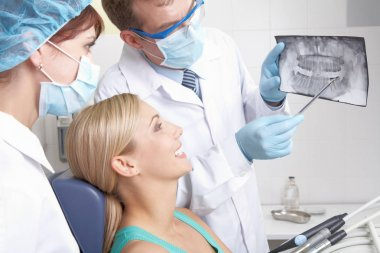 dentist showing a patient teeth x-ray