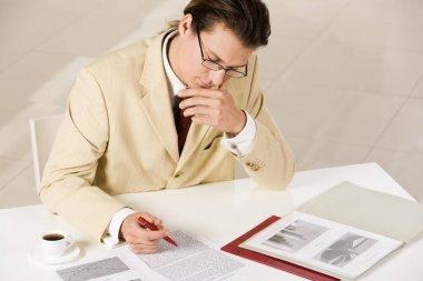thinking businessman reading