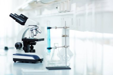 Microscope and chemical glassware in lab