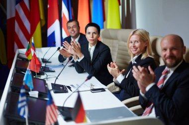 politicians clapping hands after speech