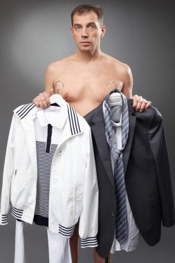 bachelor holding clothes at morning
