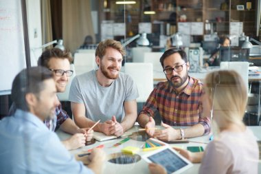 Confident employees having discussion of ideas