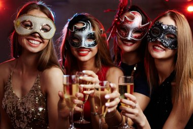 girls in carnival masks enjoying party