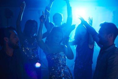 friends enjoying disco in club