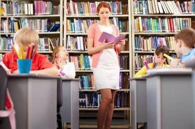 woman teaching children in elementary school