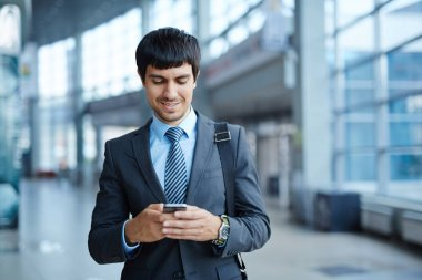 Businessman writing sms in office center