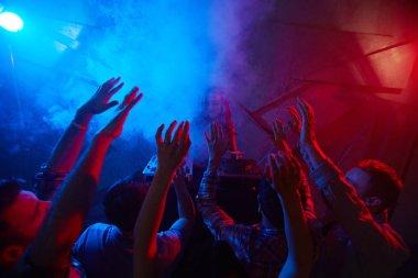 friends dancing in night club