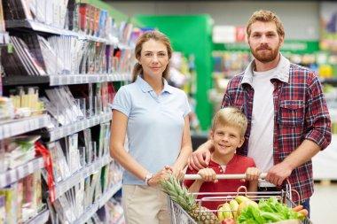 Family shopping in hypermarket