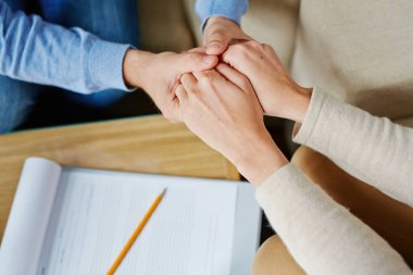 Man and woman holding by hands