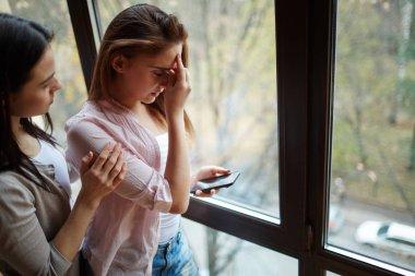 girl reassuring her worried friend