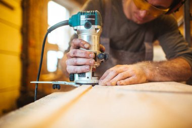 handyman cutting wooden board