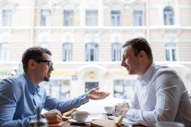 entrepreneurs talking at lunch break
