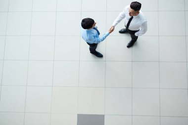 two modern agents handshaking