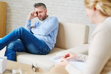 Man telling his story to psychotherapist
