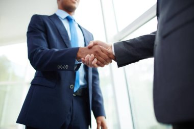 businessmen handshaking after making deal