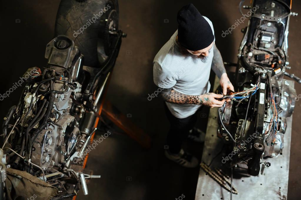 technician repairing custom-bikes in garage