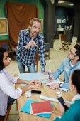 Fotografie Businesspeople discussing strategies