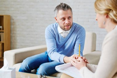 Man expressing empathy to woman