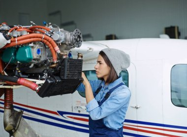 Young woman checking air jet motor