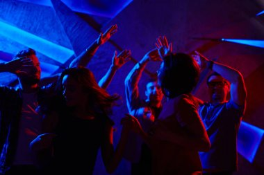 Crowd of friends dancing