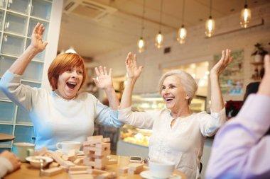 Seniors spending time in cafe
