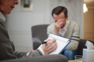man during visit to psychologist