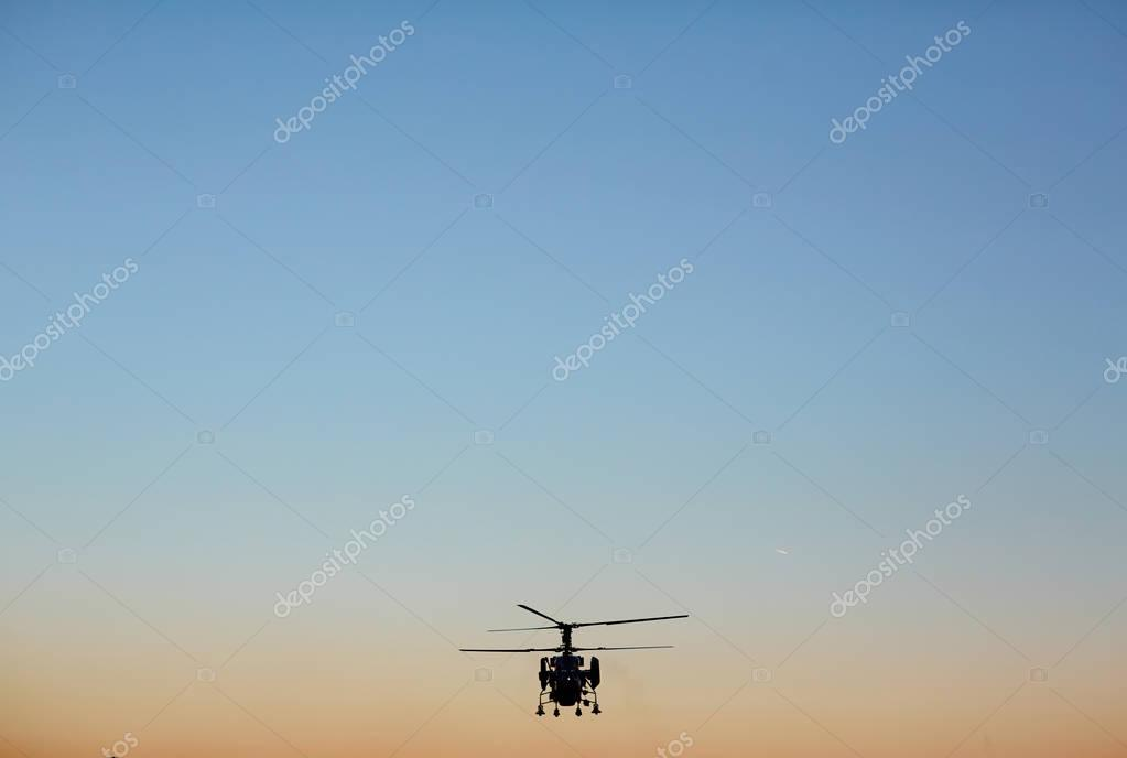 rescue helicopter on evening sky