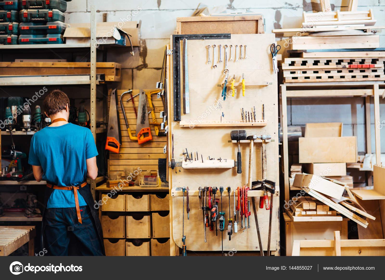 Cabinetmaker Choosing Tools For Work Stock Photo C Pressmaster