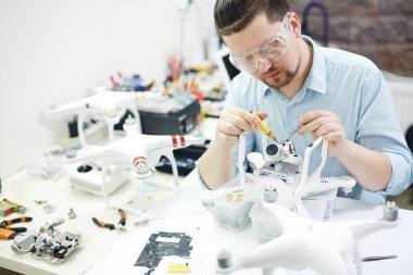 man assembling drones