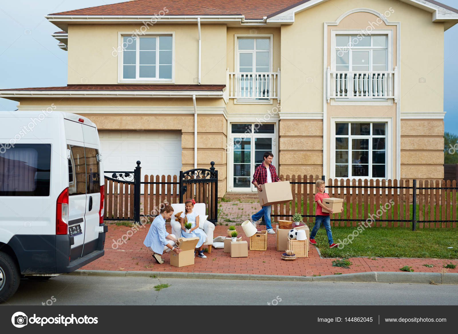 Big family moving in new house stock photo pressmaster for Moving to new house