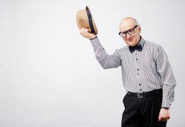 man  taking his bowler hat off