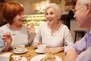 pensioners enjoying their hangout in cafe