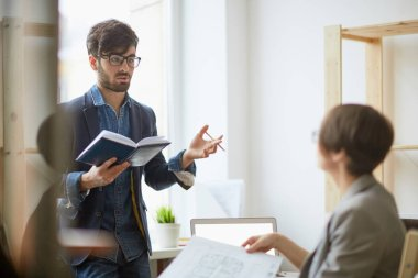 Portrait of two employees talking in office: successful project manager giving instructions to colleague discussing architectural plans stock vector