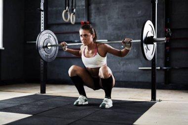 sportswoman ready to perform exercise